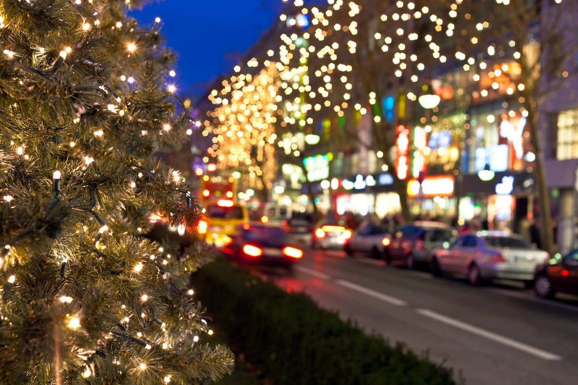 Christmas tree with traffic in the city. Focus on the tree.