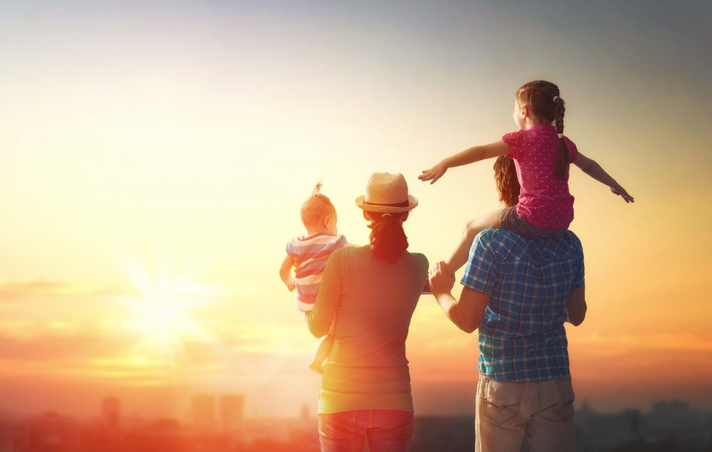 happy family travels to attractions at sunset